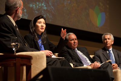 From left, Frank DiSalvo, Sheryl WuDunn, Armando Olivera and Fred Krupp speak about the importance of increased awareness, policy changes and an inclusive approach for achieving sustainability in a discussion Oct. 28 in Statler Hall. (Jason Koski/University Photography)