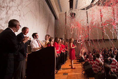 Streamers, singers and the Big Red Marching Band celebrate the single largest gift to the Ithaca campus from an individual. (Jason Koski/University Photography)