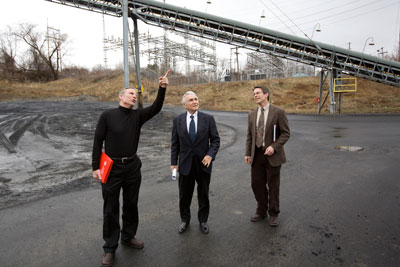 Jason Koski/University Photo - U.S. Rep. Maurice Hinchey, center, tours the Combined Heat and Power Plant with, from left, Bert Bland, senior director of energy and sustainability, and Lanny Joyce, director of energy management, during Hinchey's visit to campus March 21.